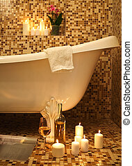 Home bathroom interior with bubble bath, candles, magazine...