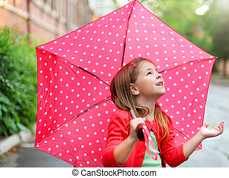 Little girl with polka dots umbrella under the rain - Child...