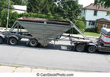 Truck pulls a gravel carrier