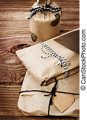 Presents wraped in a rustic earthy style - Hand crafted...