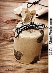 Holiday presents wraped in a rustic earthy style - Hand...