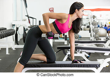 Girl in health club - Young women do a workout at the gym