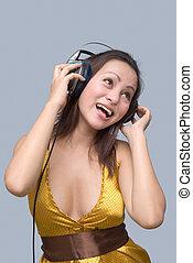 Cheering girl with headphones