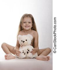 Four-year-old girl bear hug