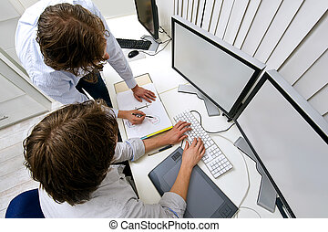 Working together - Two engineers, working together in an...
