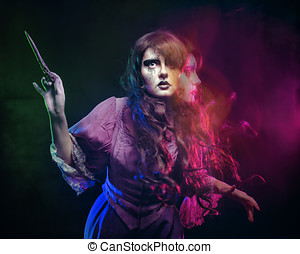 Witch and the magic wand - Girl in the image of a witch with...