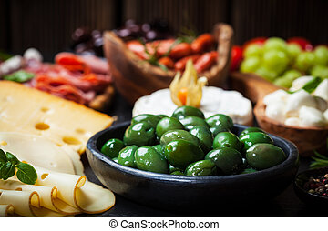 Antipasto with green olives - Antipasto and catering platter...