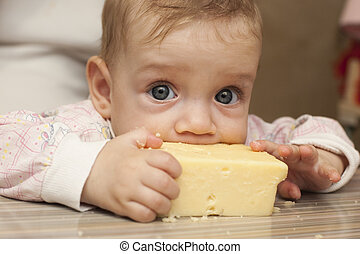 Seven-month baby eats a big piece o - Seven-month baby...