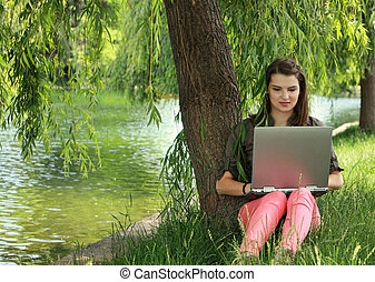 Young Woman Studying Outside