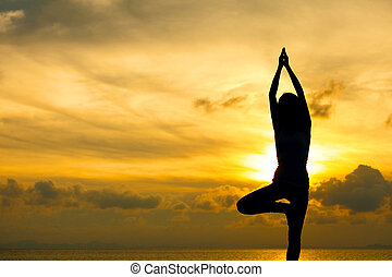 Silhouette of beautiful Yoga woman in morning