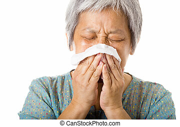 Asian old woman sneezing