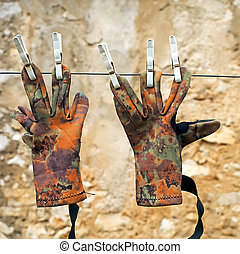 Mimetic gloves - Gloves of hunter on the clothesline