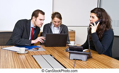 Small Business team - A small business team in a cubicle...