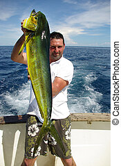 Dolphin fish mahi-mahi - Lucky fisherman holding a beautiful...
