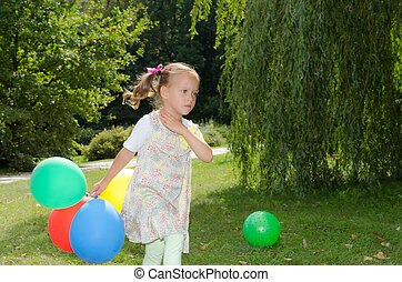 small girls with aerial balloon