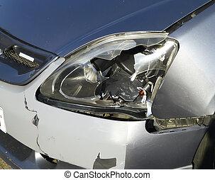 Broken car headlight - A broken gray car headlight