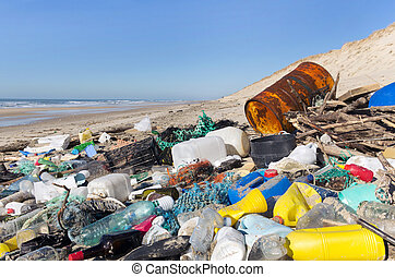 Beach pollution - garbages, plastic, and wastes on the beach