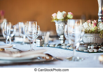 Decorated table with glassware and cutlery at a wedding...