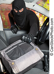 Thief stealing a car - Thief stealing a handbag from a woman...