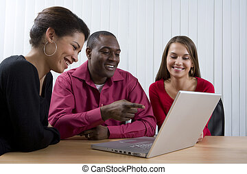 Co-workers looking at laptop