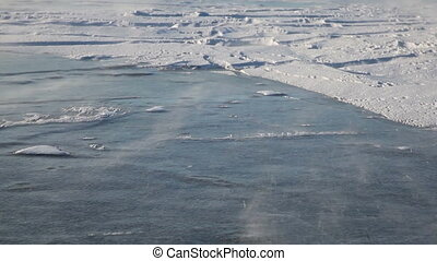 Drifting snow on Baikal lake - Baikal lake in Siberia ,...