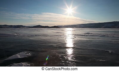 Drifting snow on Baikal lake during sunset - Baikal lake in...
