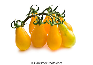 yellow cherry tomatoes on white background