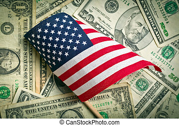 american flag with us dollars - top view american flag on us...