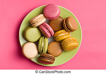 colorful macaroons on plate - colorful macaroons on pink...