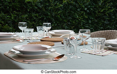 Table with tableware for picnic