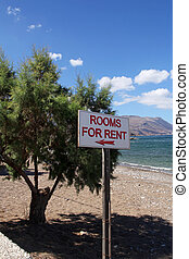 rooms for rent sign on the beach in Crete, Greek