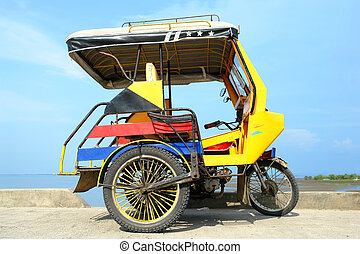 Asian tricycle - Asian colourful tricycle parked in front of...