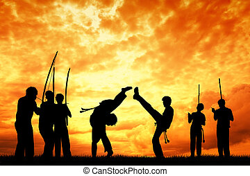 Capoeira at sunset - Capoeira silhouette at sunset