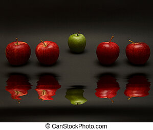 Odd One Out - A line of apples, with one red one out. (with...