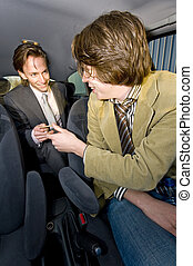 Paying the Cabbie - A businessman paying the fare to the...
