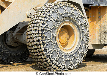 wheels with anti skid chain - closeup of photo, wheels with...