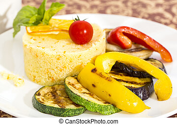couscous with grilled vegetables on a table in a restaurant