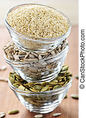Stacked bowls of seeds - Three stacked bowls of sesame...
