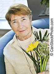 Elderly woman with flowers