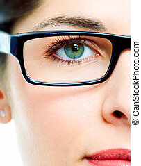 Eye in glasses - Woman's green eye in glasses close up
