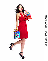 Woman with shopping bags - Young happy smiling woman with...