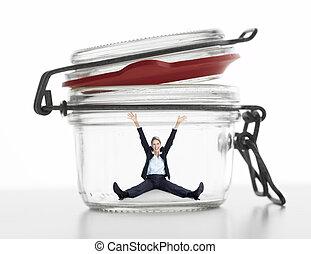 Business woman in jar.