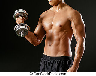 Asian man doing bicep curls - Photo of an Asian male...