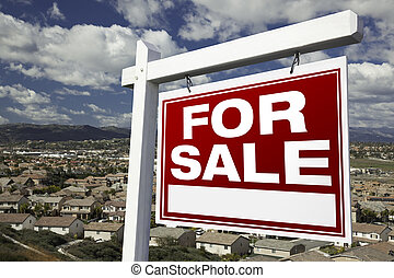 For Sale Real Estate Sign with Elevated Housing Community...