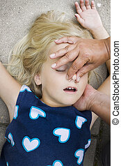 child first aid - A little girl receiving mouth to mouth...