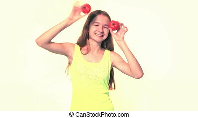 Girl playing with tomatoes