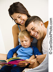 Family reading book. - Caucasian parents and toddler son...