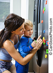 Mom with child - Caucasian toddler boy and mother playing...