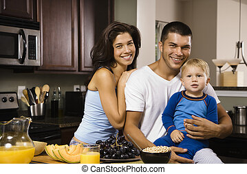 Family in kitchen - Caucasian family with toddler son in...