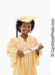 Child graduation. - African American girl in graduation robe...